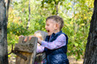 Happy Male Kid Playing at the Woods