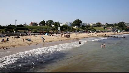 Swanage beach Dorset England UK with waves tourists