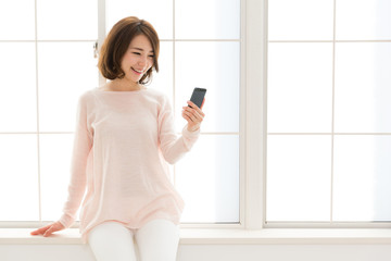 young asian woman using smart phone
