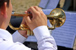 Musician playing on trumpet in street orchestra