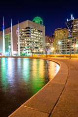 The reflecting pool at City Hall and buildings at night, in Dall
