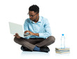 African american college student sitting with laptop on white - 78228972