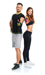 Sport man and woman after fitness exercise with a finger up on t