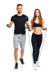 Happy sport couple - man and woman with with ropes on the white