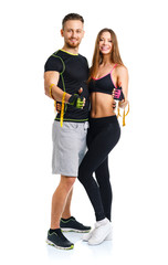Man and woman with measuring tape on the white background