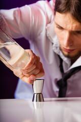 Young man bartender preparing alcohol drink