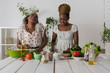 Two african women cooking salad - 78229353