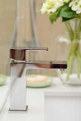 Close up of a contemporary square shaped mixer tap