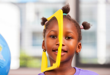 African girl in primary school playing with objects