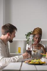Multiracial Couple Enjoying Meal