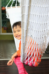 face of children sitting in clothes cradle and smiling use for f