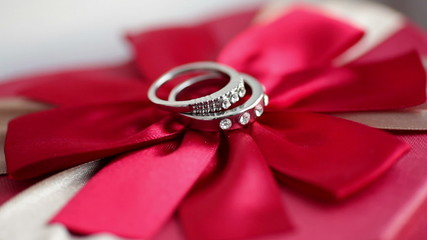 Wedding rings on a red bow