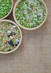 An assortment of legumes and cereals on a sackcloth