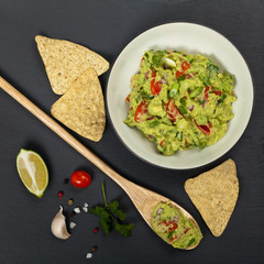 Guacamole on black background. Selective focus.