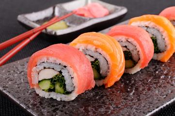 Salmon & tuna sushi roll with chopsticks