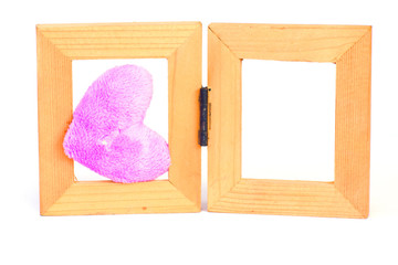 purple fabric hearts on wood frame - Stock Image