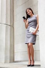 Business woman lawyer reading app on smartphone