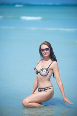 Beautiful girl poses on the beach