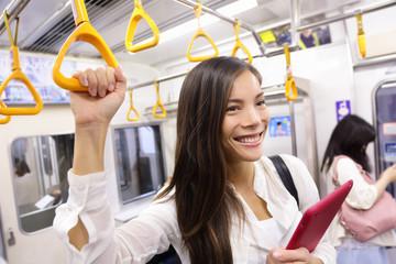 Subway commuter woman on Tokyo public transport