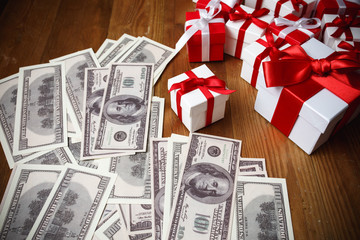 Gift box with dollar on wooden