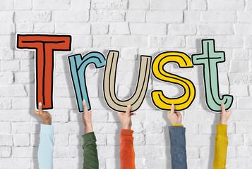 Group Hands Holding Letter Trust Concept
