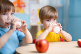 children eating healthy food at home