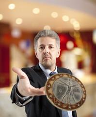 Businessman throws a coin