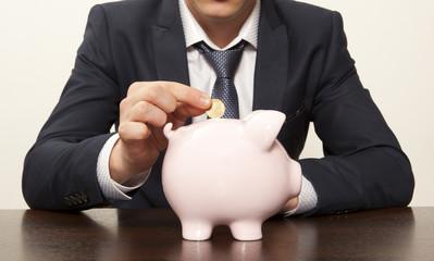 Businessman with pink piggy bank