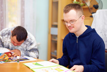 """Постер, картина, фотообои """"young adult man engages in self study, in rehabilitation center"""""""