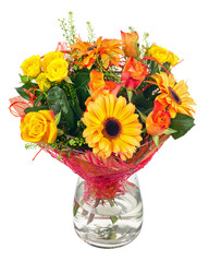 Bouquet of gerbera, roses and other flowers in glass vase.