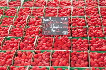 Ripe raspberries on the market