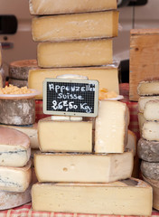 Farmer cheese with price labels on the market
