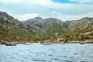 Boats in small beach bay in Massif des Calanques
