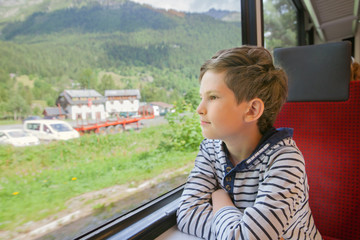 the child is traveling in a train