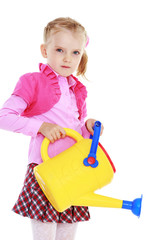 Cute little girl holding a watering can.