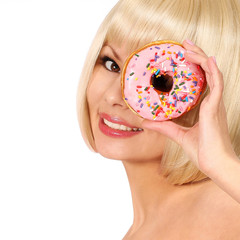 Smiling young woman with colorful donut isolated