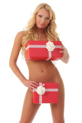 girl is covered with boxes of gifts