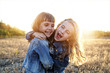 canvas print picture - Two young girls have fun outside