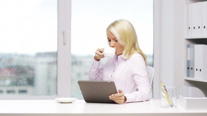 smiling woman secretary with tablet pc and coffee