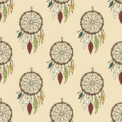 Seamless vector illustration with dream catchers on a colored ba