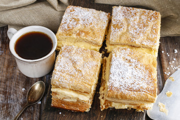 A Polish cream pie made of two layers of puff pastry, filled wit