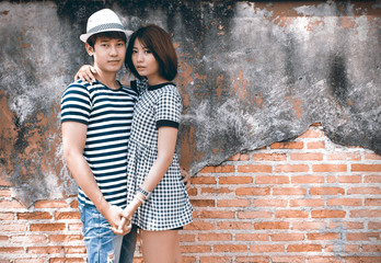 portrait of attractive asian couple in old town