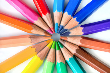 Colorful pencils in circle on white background