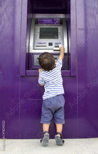 Little Boy Getting Money From An ATM - 78242322