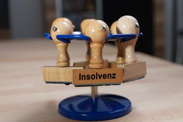 Stempel und Stempelhalter am Schreibtisch - Insolvenz