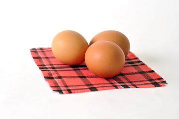 Fresh eggs on a checkered napkin