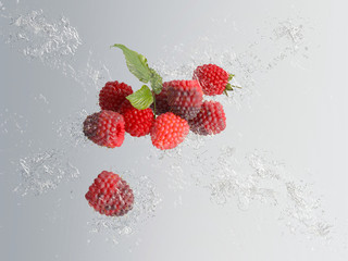 Delicious ripe red raspberries with water splash
