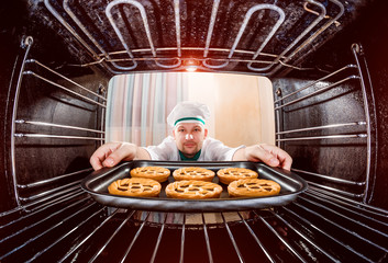 Chef cooking in the oven.