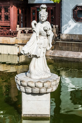 statue on a pond in Fang Bang Zhong Lu old city Shanghai China