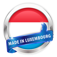 made in luxenbourg silver badge on white background